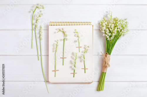 Wall Murals Lily of the valley Herbarium with lilies of the valley and flower bouquet on white wooden background