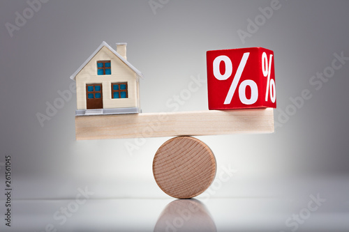 Photo  Balancing Of Percentage Red Block And House Model On Seesaw