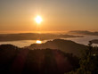 A beautiful and breathtaking view on fjords around Bergen, Norway, seen from the hill above the city. Endless fjords joining the sea. Sun sets over the horizon. Beauty of the nature.
