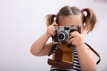 Little Girl Taking Picture Using Photo Camera