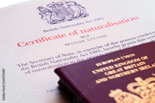 Fényképezés  Image of the new issued pre brexit style British passports with naturalization c