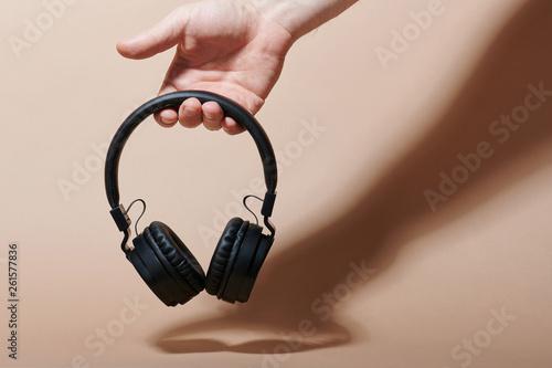 Fotomural  One modern headphones in hand