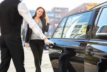 Chauffeur Opening Door For Bus...