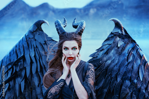 charming portrait of dark angel with sharp horns and claws on strong powerful wi Fototapet