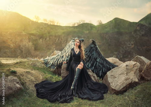 revived gargoyle, queen of night watching sunrise, girl in long light black dres Fototapet