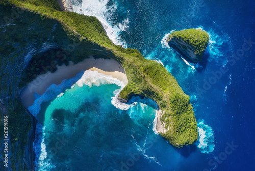 Aerial view at sea and rocks. Turquoise water background from top view. Summer seascape from air. Kelingking beach, Nusa Penida, Bali, Indonesia. Travel - image