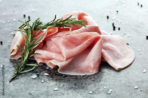 Obraz na plátně  Sliced ham on wooden background
