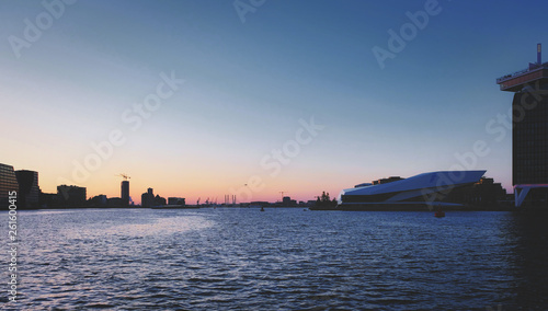 the river insude the harbour of amsterdam in sunset Wallpaper Mural