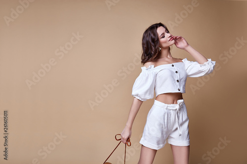 Sexy beautiful woman fashion glamour model brunette hair makeup wear blouse trousers skinny shorts clothes for every day casual party style accessory date walk girl body shape studio summer trend.
