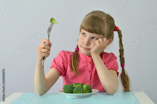 Leinwand Poster child, kid (little girl) does not want to eat broccoli