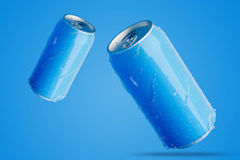 Two Blue Aluminum Cans With Wa...