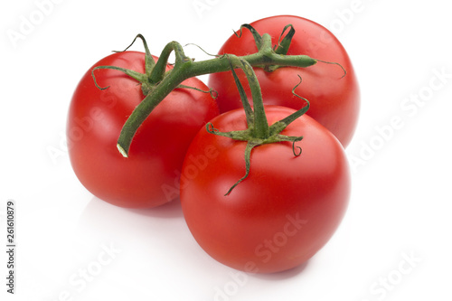 Fotografie, Obraz  closeup of three tomatoes with their branch