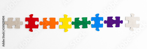 Fotografie, Obraz  equality concept: LGBT pride flag built from a puzzle, among gray puzzles short