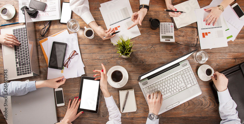 Obraz business people have meeting at office table - fototapety do salonu