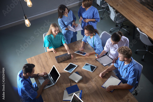 Fotografia  Group of medical students with gadgets in college, top view