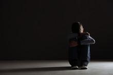 Upset Boy Sitting In Dark Room...
