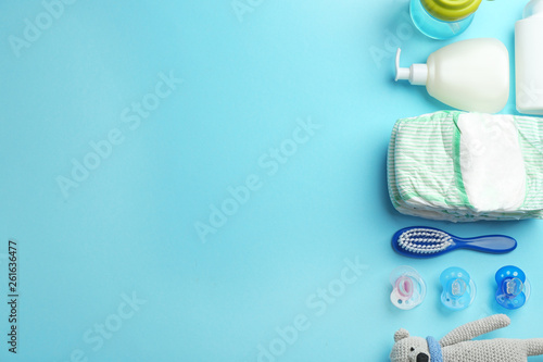 Fotografiet  Flat lay composition with baby accessories and space for text on color backgroun