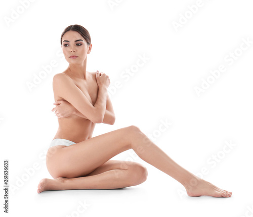 Obraz Young woman with perfect smooth skin on white background. Beauty and body care - fototapety do salonu