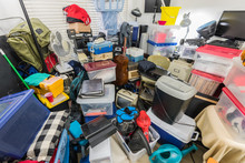 Packed Storage Room Filled With Boxes, Files, Electronics, Business Equipment, Sporting Goods And Household Items.