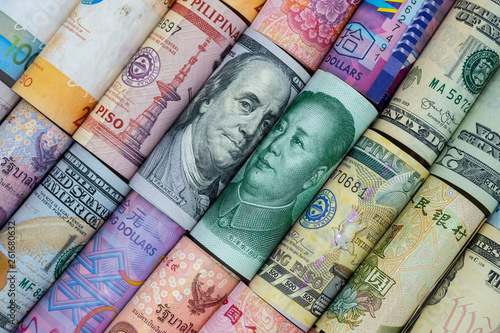 Fototapeta US dollar and China Yuan banknote  with multi countries banknotes. Its is symbol for tariff trade war crisis or unfair business of 2 biggest economic countries in the world. obraz