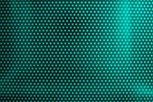 Green Light Through Perforated Bent Metal Sheet