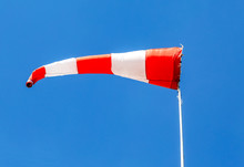 Flying Windsock Wind Vane With Red And White Lines