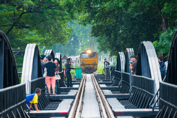 Kanchanaburi, Thailand - November 7, 2015: Train on the bridge over the River Kwai in Kanchanaburi, Thailand. This bridge is famous for its history in second world war.