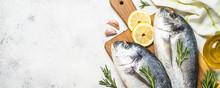 Raw Dorado Fish On Cutting Board On The Table.