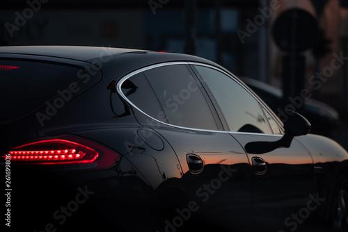 a beautiful black luxury car stuck in traffic - 261699806