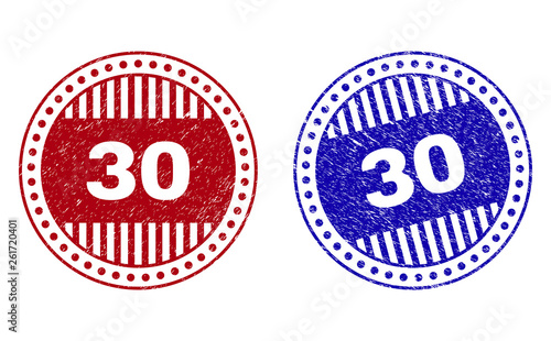Grunge 30 round stamp seals isolated on a white background. Round seals with grunge texture in red and blue colors. Vector rubber imprint of 30 label inside circle form with stripes.