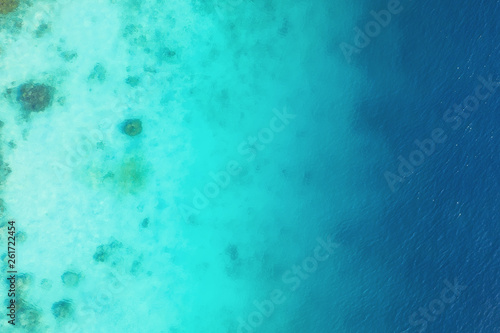 Foto auf Leinwand Reef grun Ocean as a background from top view. Turquoise water background from top view. Summer seascape from air. Gili Meno island, Indonesia. Travel - image