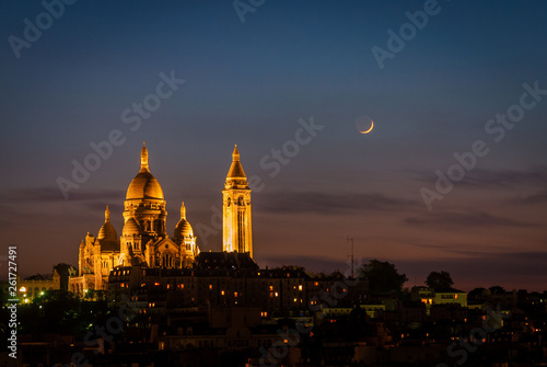 Fotografie, Obraz Illuminated Sacre Coeur Basilica and moon at night in Paris