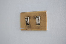 The Old And Dirty Light Switch On Wall
