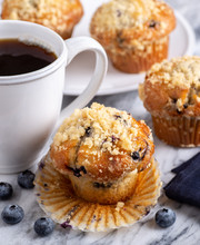 Blueberry Muffin With Berries And Cup Of Coffee