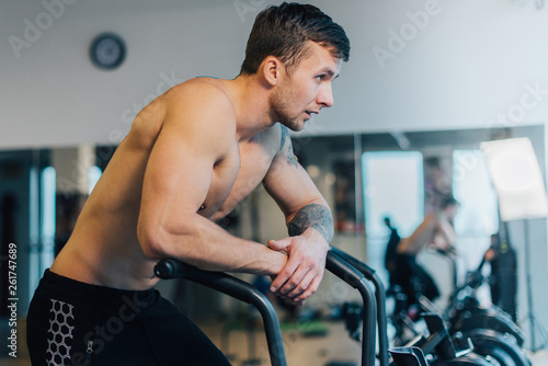 Fotografie, Obraz  Athletic man resting after workout on cycling machine