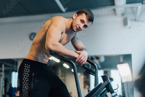 Valokuva  Athletic man resting after workout on cycling machine