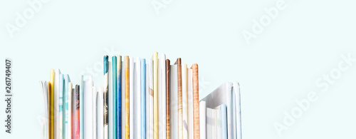 Obraz Close view of Stack of children's books on a pastel blue background. Long wide banner with copy space. - fototapety do salonu