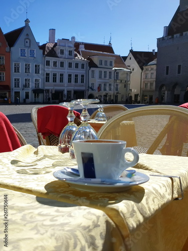 Poster Cracovie Street cafes tables and chairs in Old Town waiting for people to relax and have a cup of coffee Street restaurant in the city Summer afternoon Europe Baltic Travel