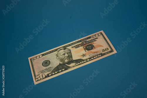 Photographie  isolated american fifty dollar bill on blue background