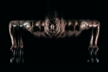 Fototapeta Fitness / Siłownia Handsome muscular man doing pushups on kettleball