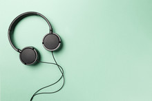 Headphones On Mint Background. Black Headphones On A Pastel Background. Top View. Flat Lay. Copy Space. Minimal Style With Colorful Paper Backdrop. Music Concept. Neo Mint Color Of The Year 2020