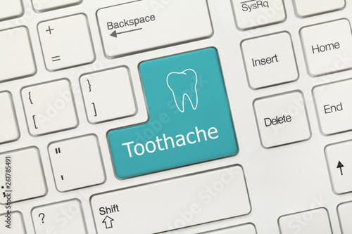 Fotografia  White conceptual keyboard - Toothache (blue key)
