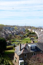 The Houses Of South Queensferry, Scotland With The Queensferry Crossing In The Background