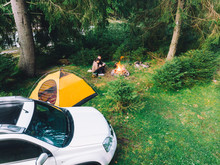 Couple Sitting Near Campfire D...