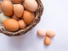 Basket Full Of Eggs On A White...