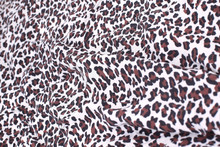 Abstract Background Composed Of Leopard Print Fabric.