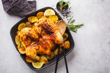 Fried Whole Tabaka Chicken With Potatoes In A Grill Pan, Top View, White Background.