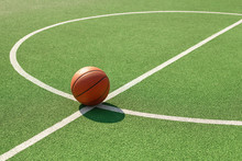 Basketball Ball On The Outdoors Court