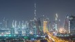 Dubai skyline with beautiful city center lights and Sheikh Zayed road traffic night timelapse. Illuminated towers and skyscrapers aerial view from zabeel district. Dubai, United Arab Emirates