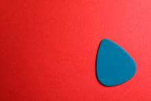 Blue Guitar Pick On Color Back...